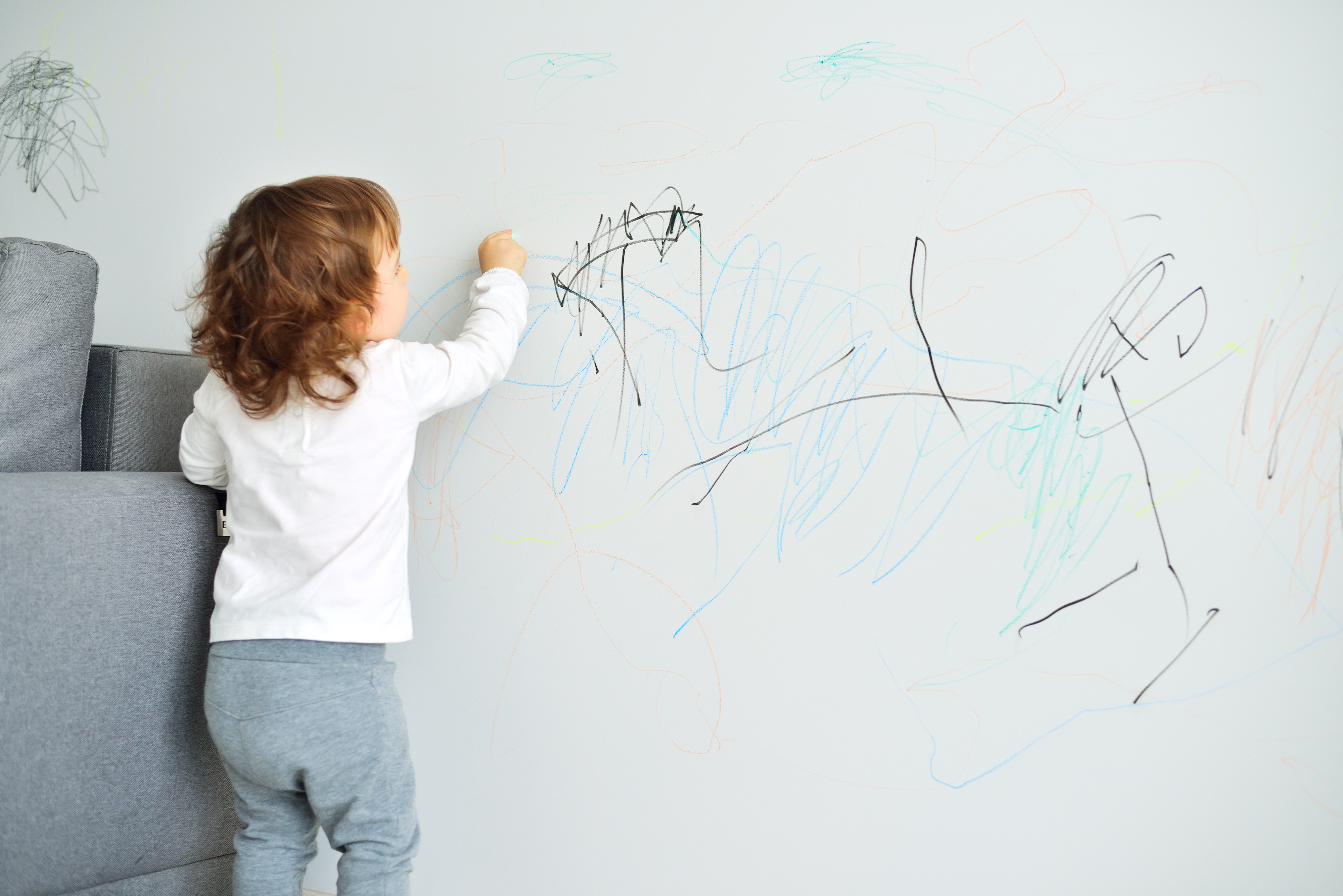 Child drawing on walls