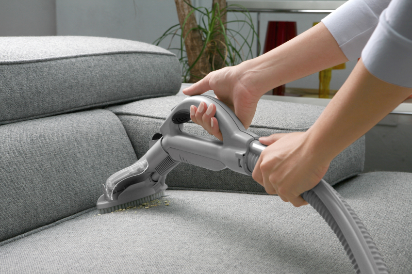 Cleaning furniture with a vacuum