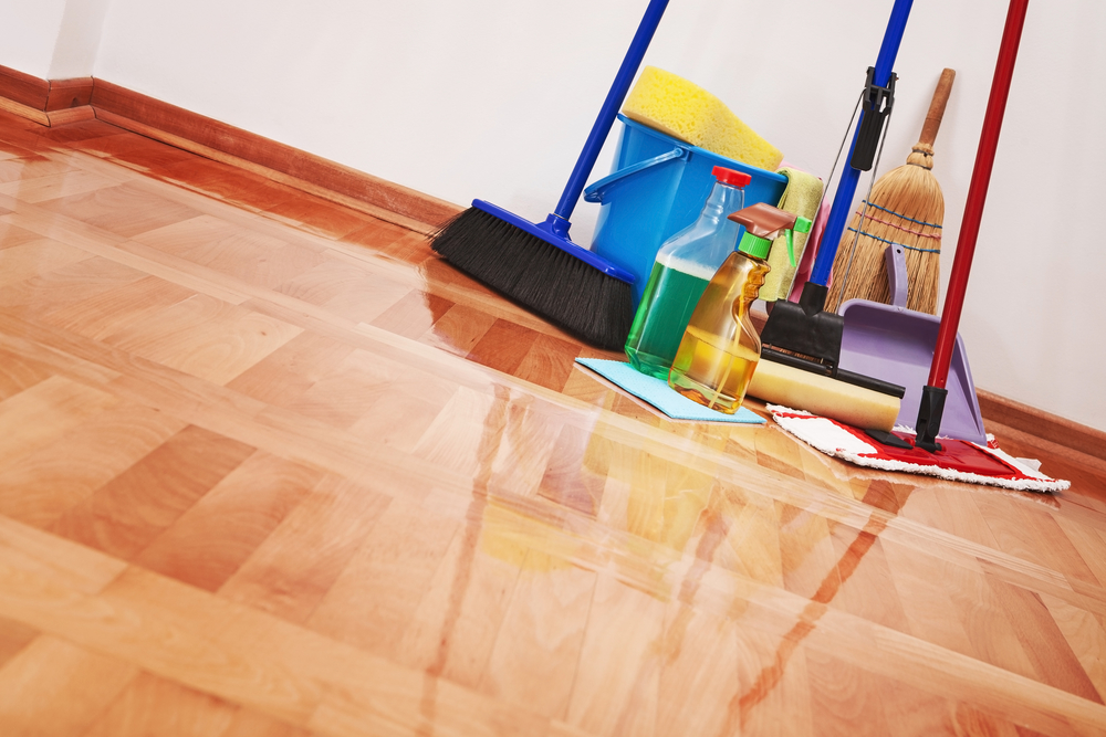 Cleaning tools on a clean wood floor