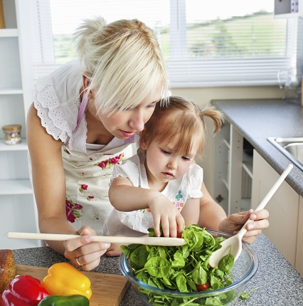 mother and daughter creating a salad